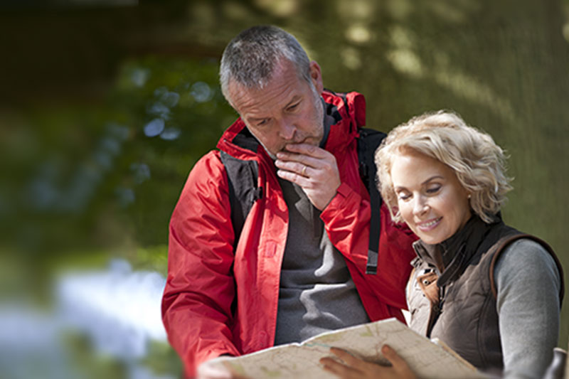 Elderly Couple Looking At Map