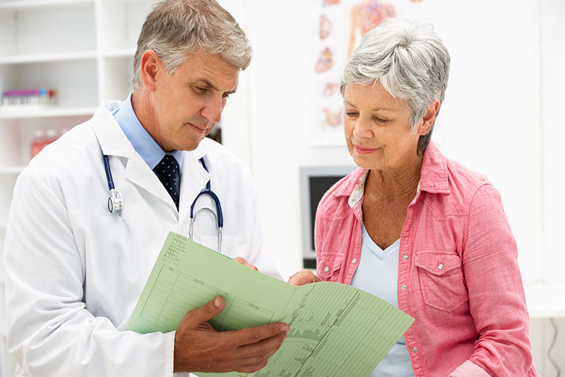 Elderly Women Talking To Doctor