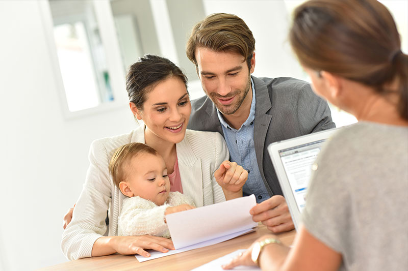 Young Family Reviewing Legal Documents